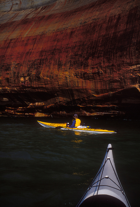 Sea kayakers explore the colored cliffs of Pictured Rocks National Lakeshore near Munising, Mich.