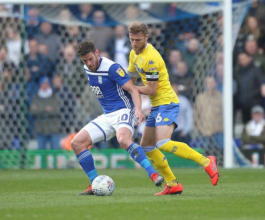 Leeds United's Liam Cooper battles with  Birmingham City's Lukas Jutkiewicz<br /> <br /> Photographer Mick Walker/CameraSport<br /> <br /> The EFL Sky Bet Championship - Birmingham City v Leeds United - Saturday 6th April 2019 - St Andrew's - Birmingham<br /> <br /> World Copyright © 2019 CameraSport. All rights reserved. 43 Linden Ave. Countesthorpe. Leicester. England. LE8 5PG - Tel: +44 (0) 116 277 4147 - admin@camerasport.com - www.camerasport.com