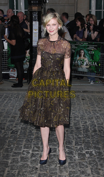 Kirsten Dunst (wearing new fashion label Honor's spring 2012 collection).UK Premiere of 'Melancholia' at the Curzon, Mayfair, London, England..September 28th 2011.full length organza paisley printed dress gold woven weave sheer black brown.CAP/ROS.©Steve Ross/Capital Pictures