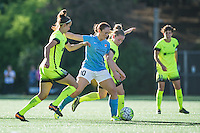 Seattle, WA - Sunday, April 17, 2016:  Sky Blue FC midfielder Ashley Nick (10) is defended by Seattle Reign FC midfielder Havana Solaun (19). Sky Blue FC defeated the Seattle Reign FC 2-1during a National Women's Soccer League (NWSL) match at Memorial Stadium.