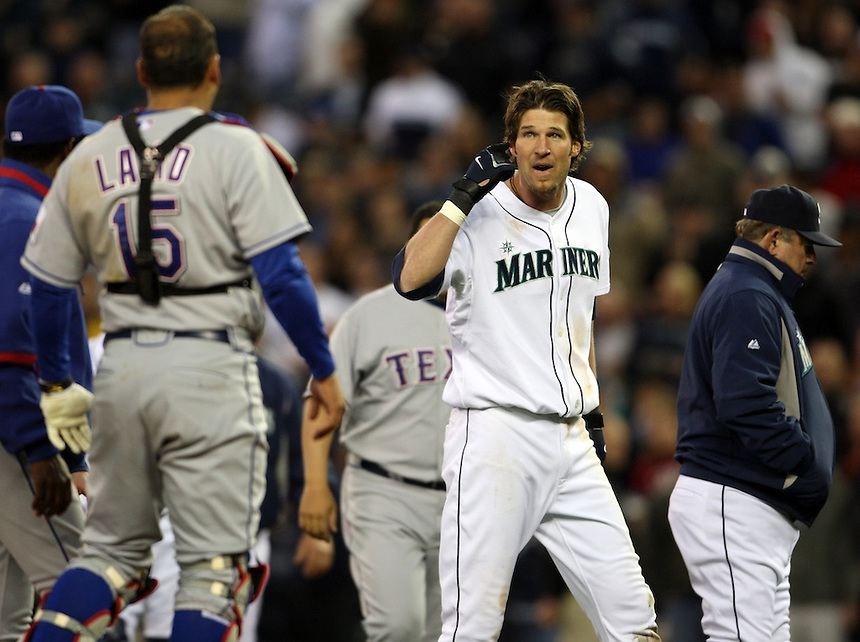 Seattle Mariners' Richie Sexson, second from right, talks to Texas Rangers' catcher Gerald Laird as Sexson is ejected after charging Texas Rangers' pitcher Kason Gabbard in the fourth inning inning of a MLB baseball game in Seattle on Thursday May 8, 2008. (AP Photo/Kevin P. Casey)