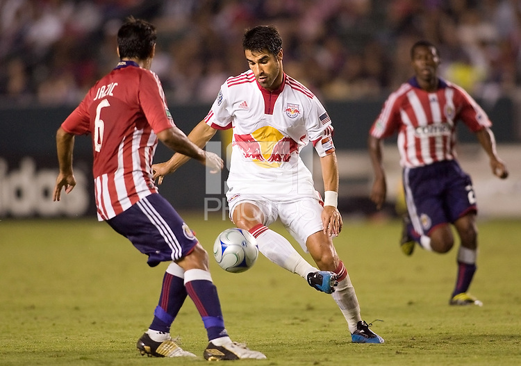 New York Red Bulls forward Juan Pablo Angel moves with the ball while being closely marked  by Chivas USA midfielder Ante Jazic. The New York Red Bulls and Chivas USA played to 1-1 tie at Home Depot Center stadium in Carson, California on Saturday September 26, 2009...