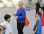 Mayor Annise Parker smiles after being presented a super-hero cape from Jack Wallace, Damian Lara and Fabian Lara on the steps of City Hall Monday April 13, 2015. The presentation came before Mayor Parker's reading of a proclamation of April as Child Abuse Prevention Month.(Dave Rossman photo)