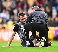 Lincoln City's Lee Frecklington receives treatment from Lincoln City's head of sports science and medicine Mike Hine<br /> <br /> Photographer Andrew Vaughan/CameraSport<br /> <br /> The EFL Sky Bet League Two - Port Vale v Lincoln City - Saturday 13th October 2018 - Vale Park - Burslem<br /> <br /> World Copyright © 2018 CameraSport. All rights reserved. 43 Linden Ave. Countesthorpe. Leicester. England. LE8 5PG - Tel: +44 (0) 116 277 4147 - admin@camerasport.com - www.camerasport.com