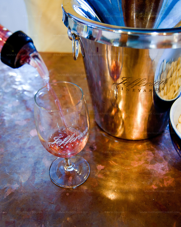 A taste is poured into my glass on the copper tasting bar at Jefferson Vineyards.