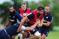 Elliott Stooke of Bath Rugby takes on the defence. Bath Rugby pre-season training session on August 9, 2016 at Farleigh House in Bath, England. Photo by: Patrick Khachfe / Onside Images