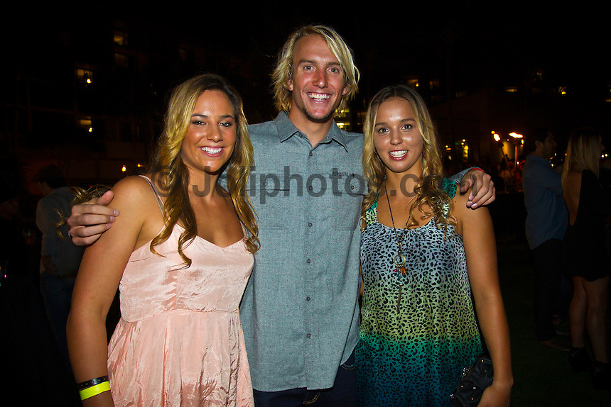Haleiwa Hawaii, (Monday December 6, 2010) .Monday, Tyler Wright (AUS), Owen Wright (AUS) and Sally Fitzgibbons (AUS).  40th annual SURFER Poll Awards were held tonight at Turtle Bay Resort on Oahu's North Shore..Sal Masekela (USA)  returned to serve as the Master of Ceremonies for the event with charismatic Hawaiian surf star Fred Patacchia as co-host .This year's SURFER Poll Awards were held in honor of recently lost legend, three-time World Champion Andy Irons. While acknowledging all of the surfers lost this year, the event  put a heavy focus on Andy and the legacy he leaves behind in and out of the water. Another focal point of this year's show was  Kelly Slater's 10th world title win. Touted as the world's most dominant athlete, Kelly's accomplishments have catapulted the sport of surfing and garnered the world's attention. Kelly was award the male Surfer of the Year award with Stephanie Gilmore (AUS) taking out the Female Surfer of the Year..Photo: joliphotos.com