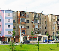 Street scene with typical colourful houses, in rather bad shape. Tirana capital. Albania, Balkan, Europe.