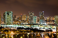 I had a lot of fun photographing the Honolulu skyline at night.  On overcast nights, the city lights created a glow in the clouds that balanced my exposure quite well.<br /> <br /> Canon EOS 5D, 70-200 f/2.8L lens