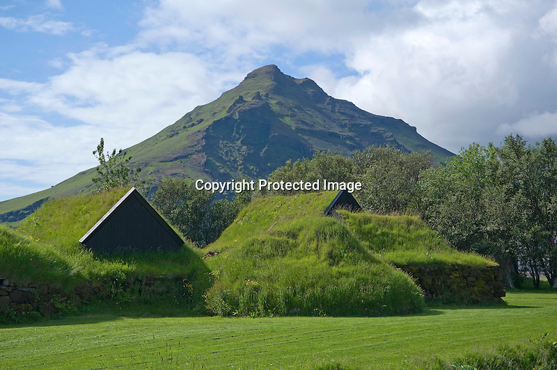 Sod Roofs and Mountain at Skogar Folk Museum on the South Coast of Iceland