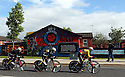 Team Colombia cycle past pro-British Loyalist murals of east Belfast during practice session before the 2014 Giro d'Italia cycling race in Belfast, Northern Ireland, 09 May 2014. Belfast is hosting the Giro d'Italia Big Start (Grande Partenza) with three days of cycling action from 9 to 11 May 2014.