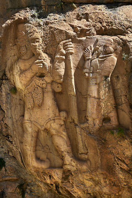 "Picture of the Ivriz Hittite rock relief sculpture monument  dedicated to King Warpalawas in which he talks to Tarhundas the God of Thunder. The king is positioned in the opposite of god, smaller and in a praying position. Warpalawas is saying ""1 am Warpalawas the king of Tuwana, the ruler and a hero. I planted these grapes while I was a young prince in the palace. Let the god Tarhundas give plenitude and fertility."" Ivriz, Turkey"
