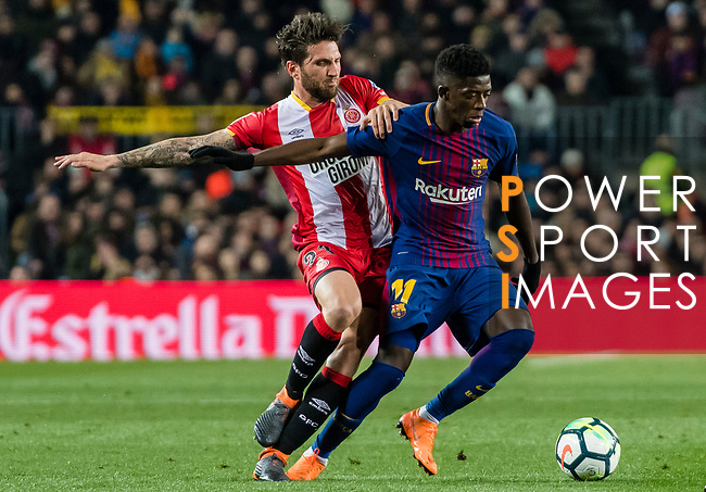 Ousmane Dembele of FC Barcelona (R) fights for the ball with Carles Planas Antolinez of Girona FC (L) during the La Liga 2017-18 match between FC Barcelona and Girona FC at Camp Nou on 24 February 2018 in Barcelona, Spain. Photo by Vicens Gimenez / Power Sport Images