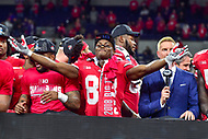 Indianapolis, IN - DEC 1, 2018: Ohio State Buckeyes wide receiver Terry McLaurin (83) celebrates on the podium with teammates after defeating the Northwestern Wildcats 45-24 in the Big Ten Championship game at Lucas Oil Stadium in Indianapolis, IN. (Photo by Phillip Peters/Media Images International)