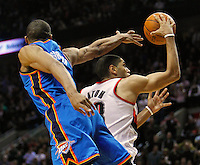 Portland Trail Blazers small forward Nicolas Batum (right) drives past Oklahoma City Thunder point guard Russell Westbrook (left) during third quarter of NBA basketball game in Portland, Oregon,  February 6, 2012.  REUTERS/Steve Dipaola (UNITED STATES)