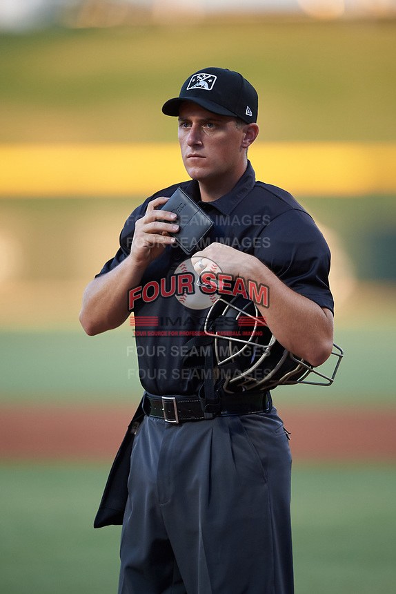 Home plate umpire Jarrod Moehlmann puts his notebook in his pocket during an Arizona League game between the AZL Dbacks and AZL Cubs 2 on June 25, 2019 at Sloan Park in Mesa, Arizona. AZL Cubs 2 defeated the AZL Dbacks 4-0. (Zachary Lucy/Four Seam Images)