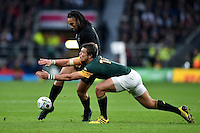 Ma'a Nonu of New Zealand puts boot to ball as Handre Pollard of South Africa looks to charge him down. Rugby World Cup Semi Final between South Africa and New Zealand on October 24, 2015 at Twickenham Stadium in London, England. Photo by: Patrick Khachfe / Onside Images