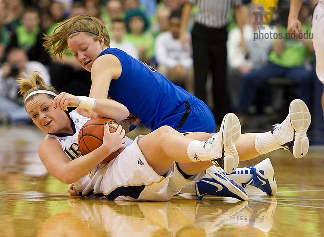 February 5, 2012; Brittany Mallory and DePaul guard Megan Rogowski battle for a loose ball during the first half. Notre Dame won 90-70. Photo by Barbara Johnston/University of Notre Dame