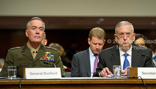"""United States Secretary of Defense James N. Mattis, right, and General Joseph F. Dunford, Jr., US Marine Corps, Chairman of the Joint Chiefs of Staff, left, give testimony before the US Senate Committee on Armed Services on """"the Department of Defense budget posture in review of the Defense Authorization Request for Fiscal Year 2018 and the Future Years Defense Program"""" on Capitol Hill in Washington, DC on Tuesday, June 13, 2017.<br /> Credit: Ron Sachs / CNP"""