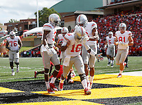 Ohio State Buckeyes quarterback J.T. Barrett (16) celebrates scoring a touchdown with wide receivers Michael Thomas (3) and Evan Spencer (6) during the fourth quarter of the NCAA football game at Byrd Stadium in College Park, Maryland on Oct. 4, 2014. (Adam Cairns / The Columbus Dispatch)