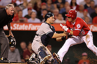 Russell Martin #55 of the New York Yankees tags out Mike Trout #27 of the Los Angeles Angels at the plate at Angel Stadium on May 29, 2012 in Anaheim,California. Los Angeles defeated New York 5-1.(Larry Goren/Four Seam Images)