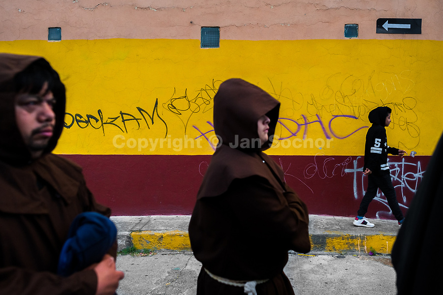 Hooded Catholic monks walk on the street during the Holy week procession in Atlixco, Mexico, 30 March 2018. Every year on Good Friday, dozens of anonymous men of all ages voluntarily undergo pain and suffering during the religious procession of the 'Engrillados' (the Shackled ones) in Puebla state, central Mexico. Wearing heavy chains on their shoulders covered with prickling cacti while being burned by the hot midday sun, they recall Jesus Christ's death by crucifixion and demonstrate their religiosity and faith.