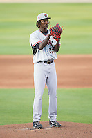 Hickory Crawdads starting pitcher Akeem Bostick (23) looks to his catcher for the sign against the Kannapolis Intimidators at CMC-Northeast Stadium on May 19, 2014 in Kannapolis, North Carolina.  The Crawdads defeated the Intimidators 10-6.  (Brian Westerholt/Four Seam Images)