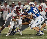 NWA Democrat-Gazette/ANTHONY REYES &bull; @NWATONYR<br /> Gary Fredrick, Rogers junior linebacker, gets a hold of Aaron McCollough, Claremore, Okla., senior, Friday, Sept. 11, 2015 at Whitey Smith Stadium in Rogers.