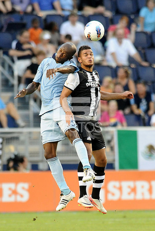 Sporting KC defender Julio Cesar ges up for a header with Hatem Ben Arfa Newcastle United... Sporting Kansas City and Newcastle United played to a 0-0 tie in an international friendly at LIVESTRONG Sporting Park, Kansas City, Kansas.
