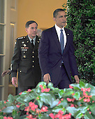 United States President Barack Obama, right, walks from the Oval Office to announce he is replacing General Stanley McChrystal, United States Army, Commander, International Security Assistance Force (ISAF) with General David H. Petraeus, Chief of the United States Central Command (CENTCOM), left, in Washington, D.C. on Wednesday, June 23, 2010..Credit: Ron Sachs / Pool via CNP