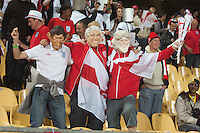 England fans wearing wigs dance in the stands at the Royal Bafokeng Stadium before the 2010 World Cup match between USA and England in Rustenberg, South Africa on Saturday, June 12, 2010.