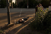 Mariupil, Ukraine.July 29, 2005..Ruslan Blagov, 27 y.o was drinking on a Friday evening and hit by a truck. He is helped by friends......
