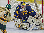 29 December 2013:  Canisius College Golden Griffins goaltender Adam Harris, a Sophomore from Penticton, British Columbia, makes a third prior save against University of Vermont Catamount Defenseman Nick Bruneteau, a Senior from Omaha, NB, at Gutterson Fieldhouse in Burlington, Vermont. The Catamounts defeated the Golden Griffins 6-2 in the 2013 Sheraton/TD Bank Catamount Cup NCAA Hockey Tournament. Mandatory Credit: Ed Wolfstein Photo *** RAW (NEF) Image File Available ***
