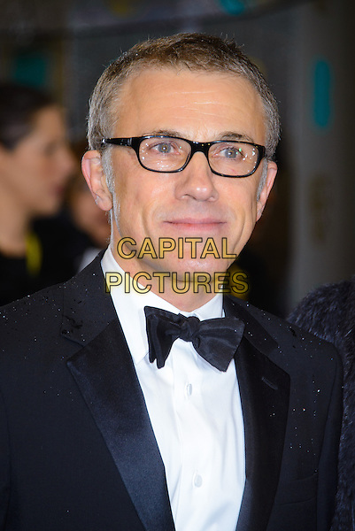 Christoph Waltz .EE British Academy Film Awards at The Royal Opera House, London, England 10th February 2013.BAFTA BAFTAS arrivals headshot portrait white black shirt tuxedo glasses  .CAP/CJ.©Chris Joseph/Capital Pictures