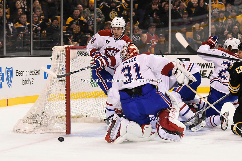 February 8, 2015 - Boston, Massachusetts, U.S. - Montreal Canadiens defenseman Alexei Emelin (74) protects the net as goalie Carey Price (31) fights to get back in posistion during the NHL game between the Montreal Canadiens and the Boston Bruins held at TD Garden in Boston Massachusetts.