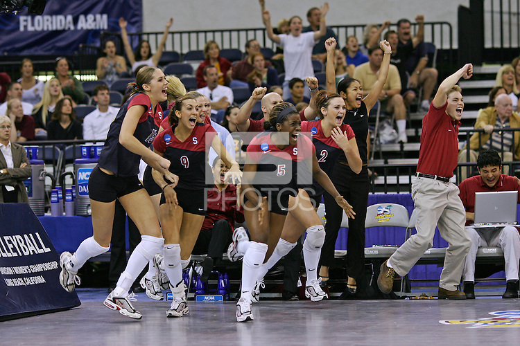 18 December 2004: Stanford's Michelle Mellard, Jennifer Wilson, Njideka Nnamani, and Katie Goldhahn rush off the bench after match point during Stanford's  30-23, 30-27, 30-21 victory over Minnesota in the 2004 NCAA Women's Volleyball National Championships in Long Beach, CA. Stanford won their sixth women's volleyball title in school history.<br />Photo credit mandatory: Marc Abrams/Stanford Athletics