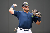 Catcher Scott Manea (25) of the Columbia Fireflies warms up before a game against the Greenville Drive on Sunday, May 27, 2018, at Spirit Communications Park in Columbia, South Carolina. Greenville won, 3-0. (Tom Priddy/Four Seam Images)