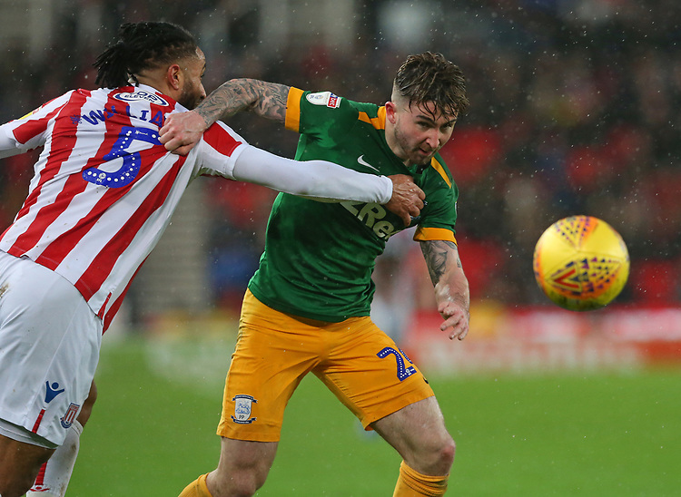 Stoke City's Ashley Williams gets to grips with Preston North End's Sean Maguire<br /> <br /> Photographer Stephen White/CameraSport<br /> <br /> The EFL Sky Bet Championship - Stoke City v Preston North End - Saturday 26th January 2019 - bet365 Stadium - Stoke-on-Trent<br /> <br /> World Copyright © 2019 CameraSport. All rights reserved. 43 Linden Ave. Countesthorpe. Leicester. England. LE8 5PG - Tel: +44 (0) 116 277 4147 - admin@camerasport.com - www.camerasport.com