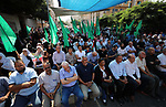 Palestinians attend a memorial service for  the prisoner Bassam Al-Sayeh who's die in the Israeli jails, in Gaza City, September 16, 2019. Al-Sayeh, 47, was detained in 2015 and was diagnosed with bone cancer in 2011 and blood cancer in 2013. Photo by Mahmoud Ajjour