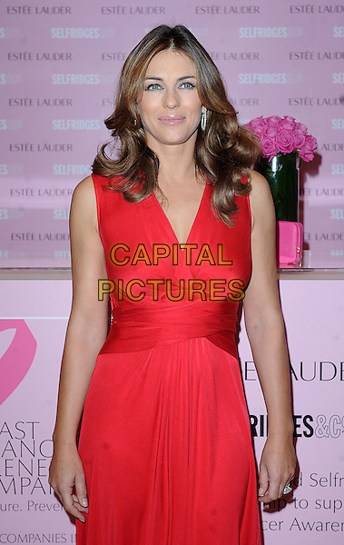 ELIZABETH HURLEY.Launches Breast Cancer Awareness products at Selfridges, Oxford Street, London, England..October 16th, 2008.half length red dress liz.CAP/BEL.©Tom Belcher/Capital Pictures.