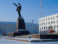 Workers clean snow around the Vladimir Lenin sculpture on Lenin Square in Yakutsk.