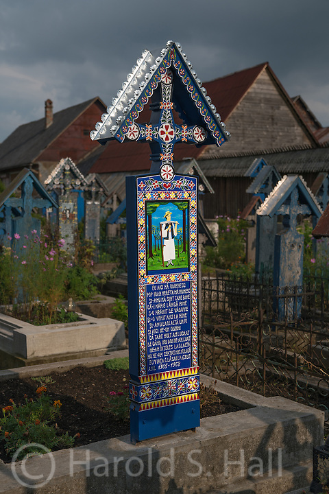 In the very most northern part of Romania, literally just yards from the Ukraine boarder, lies the small village of Sapanta.  This town has become a tourist attraction due to its unusual cemetery with hand carved bright blue oak crosses and witty rhymes about the deceased's life or sometimes what caused their death.