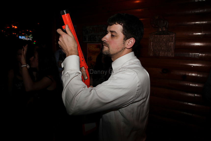 Adam Chao, 23, a process server in the financial district, competes at The Black Bear Lodge in Manhattan hosted an official Big Buck Party on Thursday April, 28, 2011. Fans of the popular hunting arcade game were invited to test their skill against other Big Buck Hunter fans to compete for prizes, enter to win raffle merchandise and meet Big Buck Girls...Danny Ghitis for The New York Times