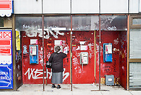 woman using phonebooth in Budapest, Hungary