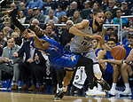 Nevada forward Caleb Martin (10) is fouled as he drive the baseline against South Dakota State in the first half of an NCAA college basketball game in Reno, Nev., Saturday, Dec. 15, 2018. (AP Photo/Tom R. Smedes)