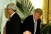 Washington, DC - September 23, 1998 -- The Speaker of the United States House of Representatives Newt Gingrich (Republican of Georgia) and United States President Bill Clinton pass one another following South African President Nelson Mandela's speech accepting the Congressional Gold Medal in the United States Capitol Rotunda on Wednesday, September 23, 1998...Credit: Ron Sachs / CNP