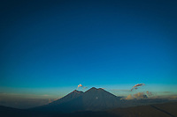 Aerial view of volcanoes Fuego (left peak) and Acatenango at sunrise in Guatemala on Thursday, Oct. 26, 2018.