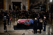 WASHINGTON, DC - DECEMBER 3 : President Donald J. Trump and first lady Melania Trump pay their respects to former president George H.W. Bush as he lies in State at the U.S. Capitol Rotunda on Capitol Hill on Monday, Dec. 03, 2018 in Washington, DC. (Photo by Jabin Botsford/Pool)