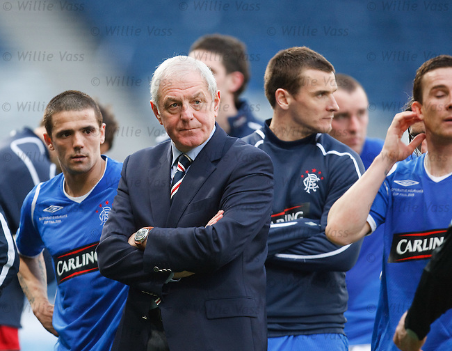 Walter Smith and the Rangers squad look on as Celtic walk up the Hampden stepa to lift the Co-Op Cup league cup trophy