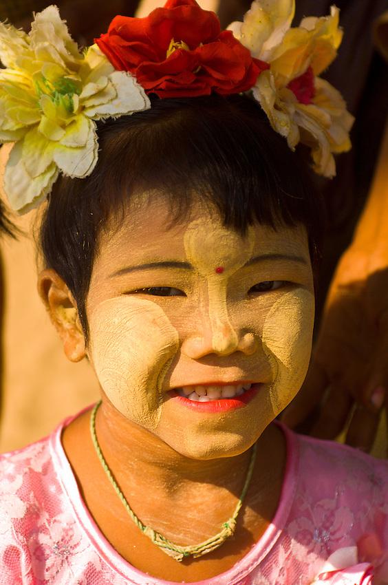 Young Burmese girl with thanaka bark sunscreen on her face, near the Hai Lo Min Lo Temple, Bagan, Myanmar (Burma)